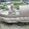 环境影雕石材 船上垂钓的老翁