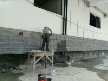 芝麻黑自然面墙面应用工地现场