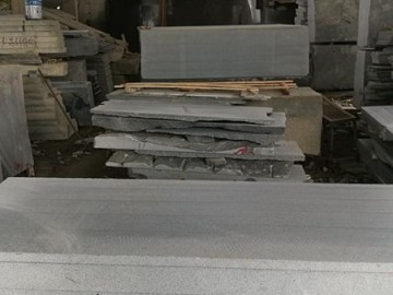 芝麻黑荒料加工条板
