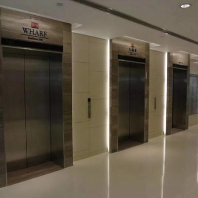 咖啡木纹大理石电梯门套应用